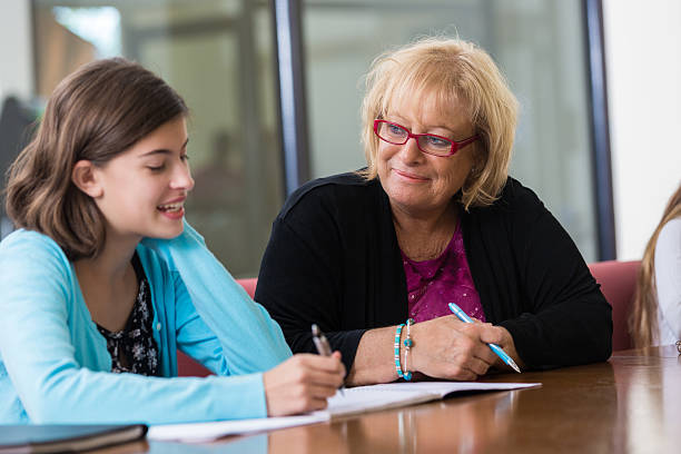 school counselor meeting with preteen student for evaluation - school counselor stock pictures, royalty-free photos & images