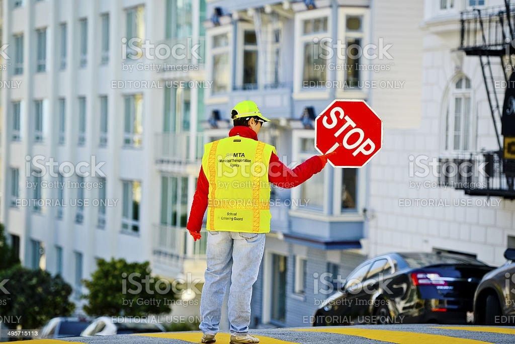 School crossing guard on San Francisco Street stock photo