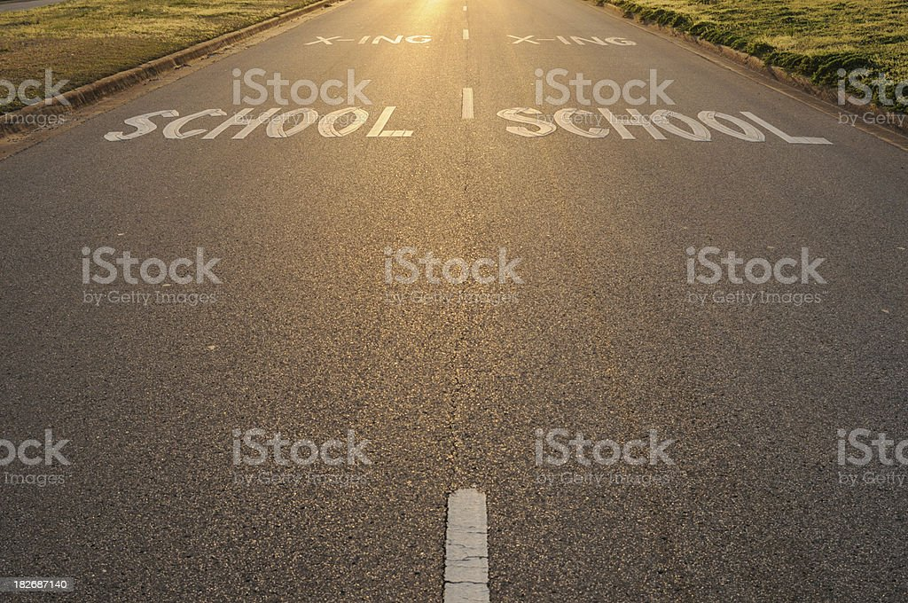 School crossing sign at sunset stock photo