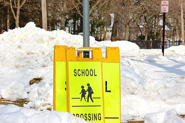 School crossing sign in snow stock photo