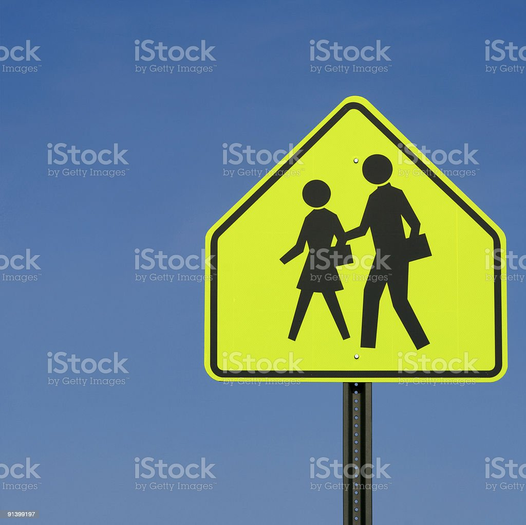School Crossing Sign Post Against Clear Blue Sky Background stock photo