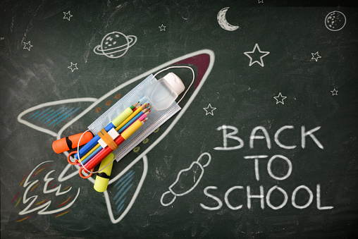 istock School design on blackboard with tools and covid-19 protection detail 1256524224