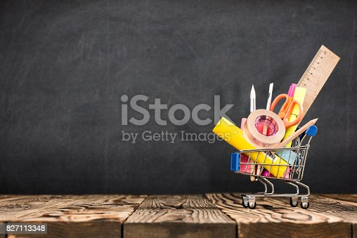 istock School Desk, Pencils And Various Supplies In Metal Shopping Holder On Blackboard Background 827113348