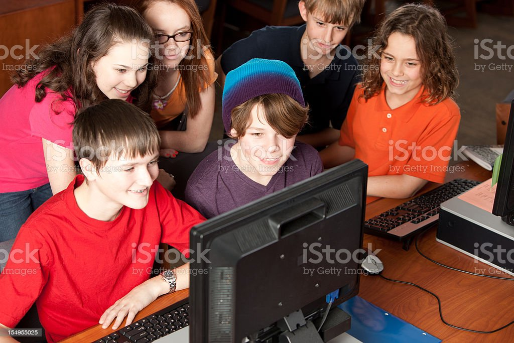 School Education: Group of Students Learning Together on Computer royalty-free stock photo