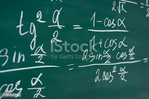 istock School, education, lesson. Mathematics formulas written on the chalboard. 1054630562