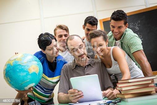 485539628 istock photo School education scene: students and teacher using tablet 482070784