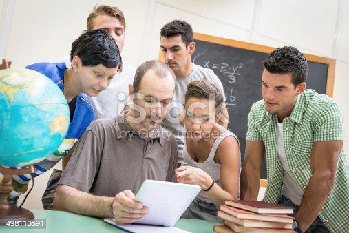 485539628 istock photo School education scene: students and teacher using tablet 498110591