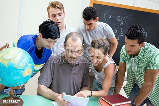 485539628 istock photo School education scene: students and teacher using tablet 531333627