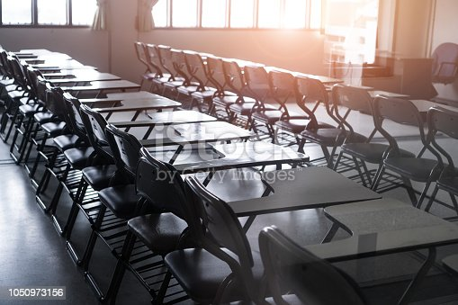 1047047834 istock photo School empty classroom or Lecture room with desks chairs iron wood for studying lessons seminar in university of thailand, interior of class with whiteboard no kid  teacher, educational concept 1050973156