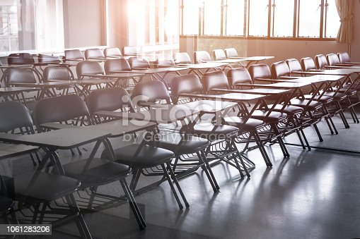 1047047834 istock photo School empty classroom or Lecture room with desks chairs iron wood for studying lessons seminar in university of thailand, interior of class with whiteboard no kid  teacher, educational concept 1061283206