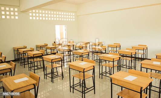 1047047834 istock photo School empty classroom with test sheet or exams paper on desks chair wood and greenboard at high school thailand, education test concept 886746098