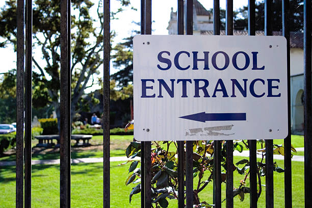 School Entrance Sign School Entrance Sign entrance sign stock pictures, royalty-free photos & images