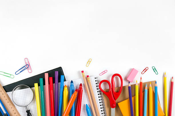 "School Equipments and Accessories ""Back to School"" concept with school supplies on white background. They are on the bottom border of it, middle of the chalkboard is empty, so you may write, or add something on it. school supplies border stock pictures, royalty-free photos & images"