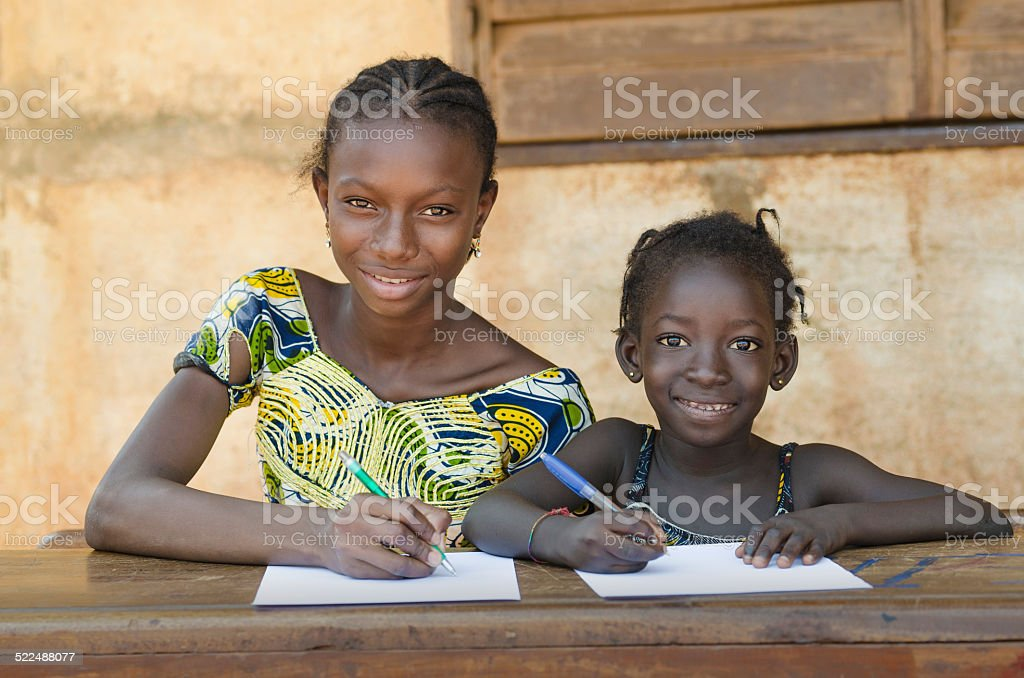 School For African Children - Couple Smiling Whilst Learning stock photo