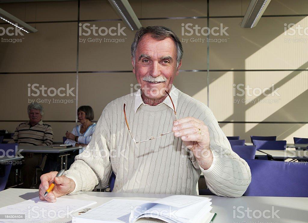 School for seniors...happy senior with glasses in his hand stock photo
