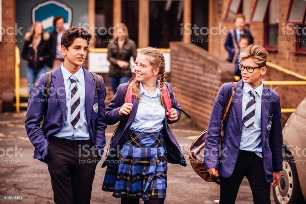 School friends leaving School for the Day stock photo