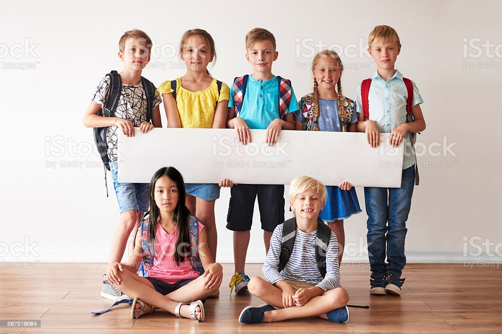 School friends with white placard stock photo