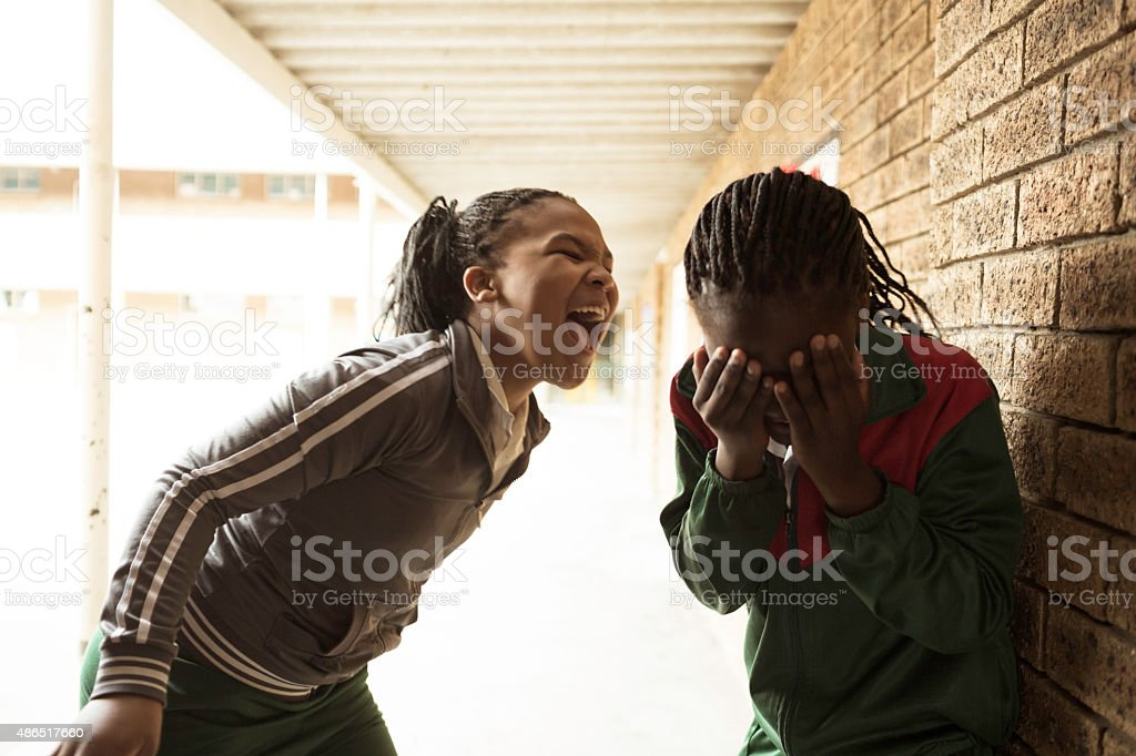 School girl bullies another girl stock photo