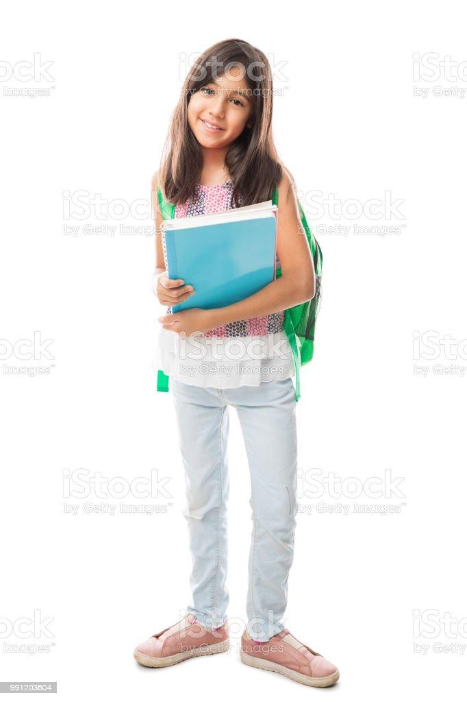 Menina de escola com a mochila e livros - foto de acervo