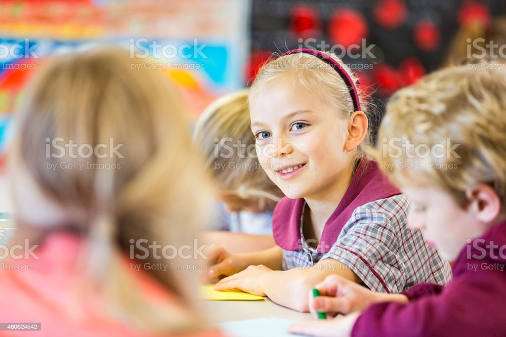 School Girl Doing a Drawing In Class stock photo