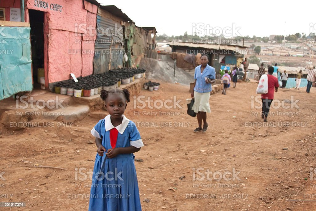 School girl go home down street of Kibera, Nairobi, Kenya. stock photo