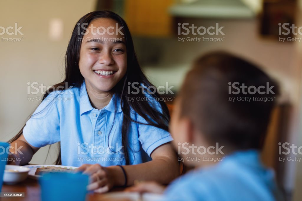 School Girl Having Breakfast stock photo