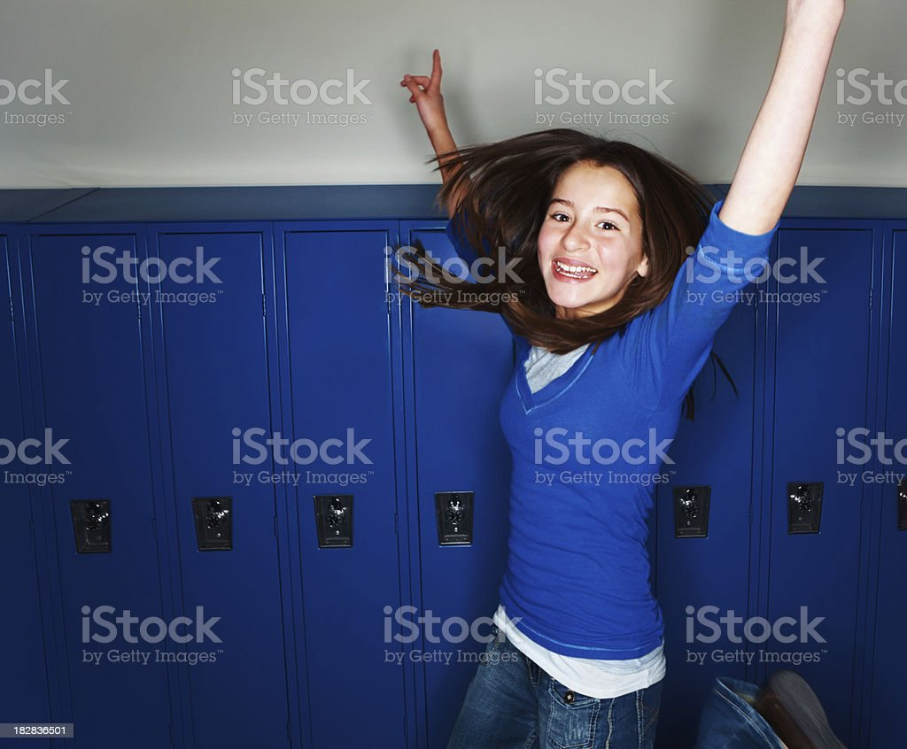 School girl jumping in joy royalty-free stock photo