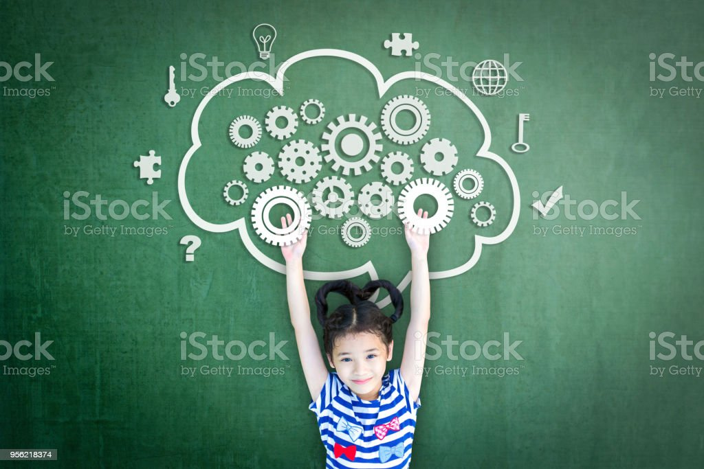 School girl kid student with cloud computing mind, smart brain imagination doodle on chalkboard for science technology education, children psychology and mental health awareness concept stock photo