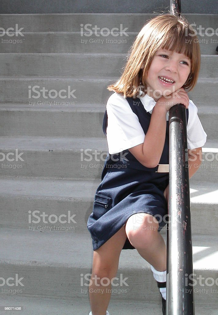 Scuola Ragazza sorridente foto stock royalty-free