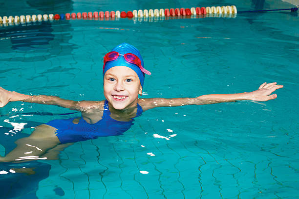 school girl swims in the sports pool - competition group stock photos and pictures