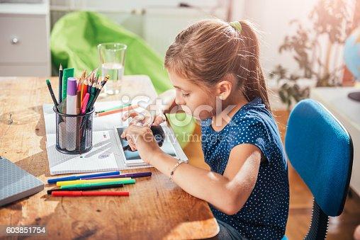 istock School Girl using tablet 603851754