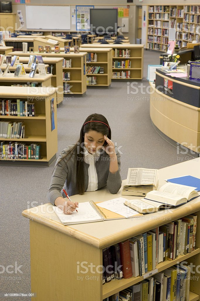 School girl working in library royalty-free stock photo