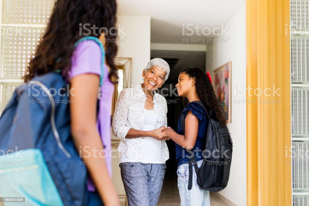 School girls arriving at grandma's house - Royalty-free 12-13 Years Stock Photo