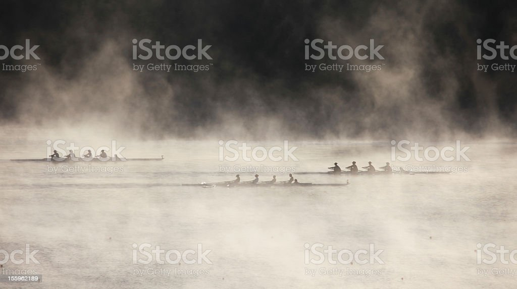 School Girls rowing in early morning mist stock photo