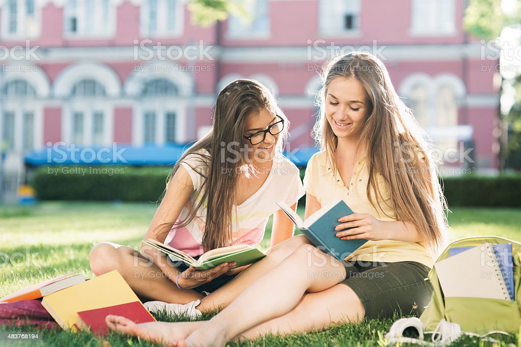 School girls studying in the campus stock photo