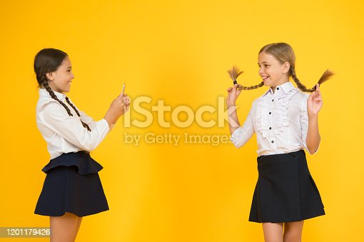 istock School girls use smartphone to take photo. Girls school uniform. Personal blog. Dont give anyone your password address or any information about your family. Life online. School application smartphone 1201179426