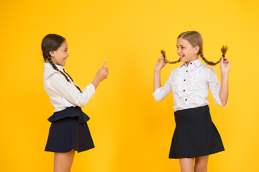 istock School girls use smartphone to take photo. Girls school uniform. Dont give anyone your password address or any information about your family. Life online. School application smartphone. Personal blog 1255932008