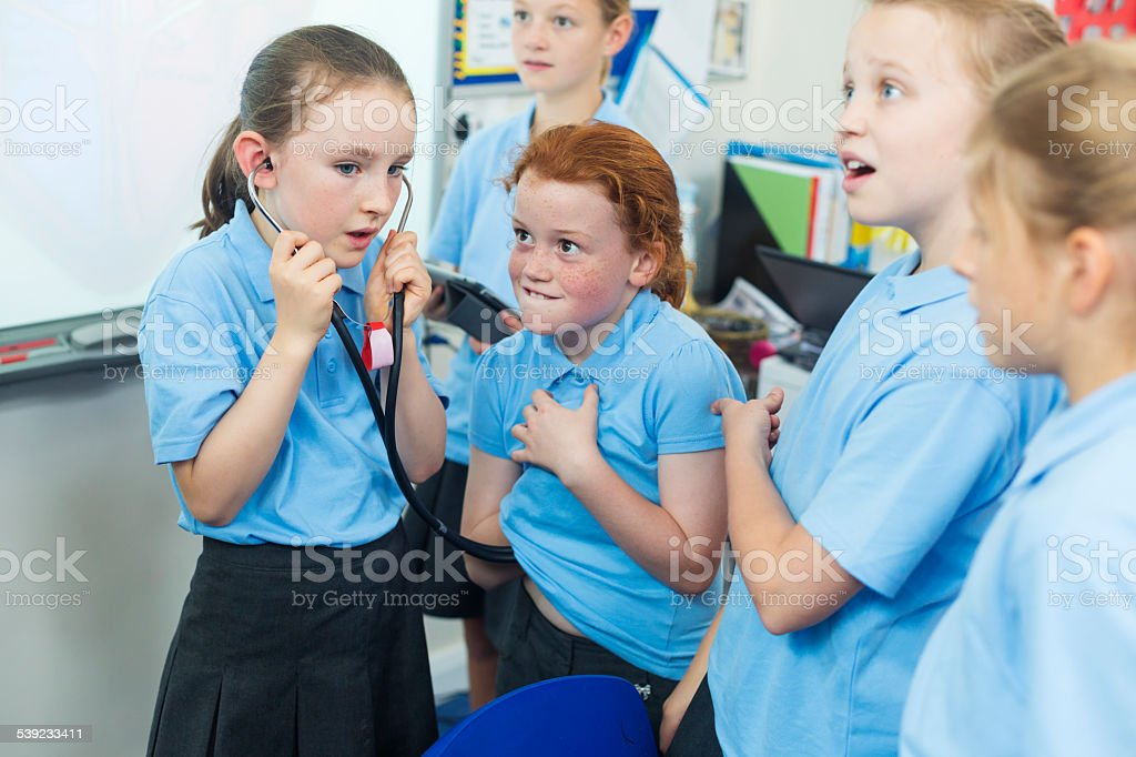 School Girls With Stethoscope royalty-free stock photo