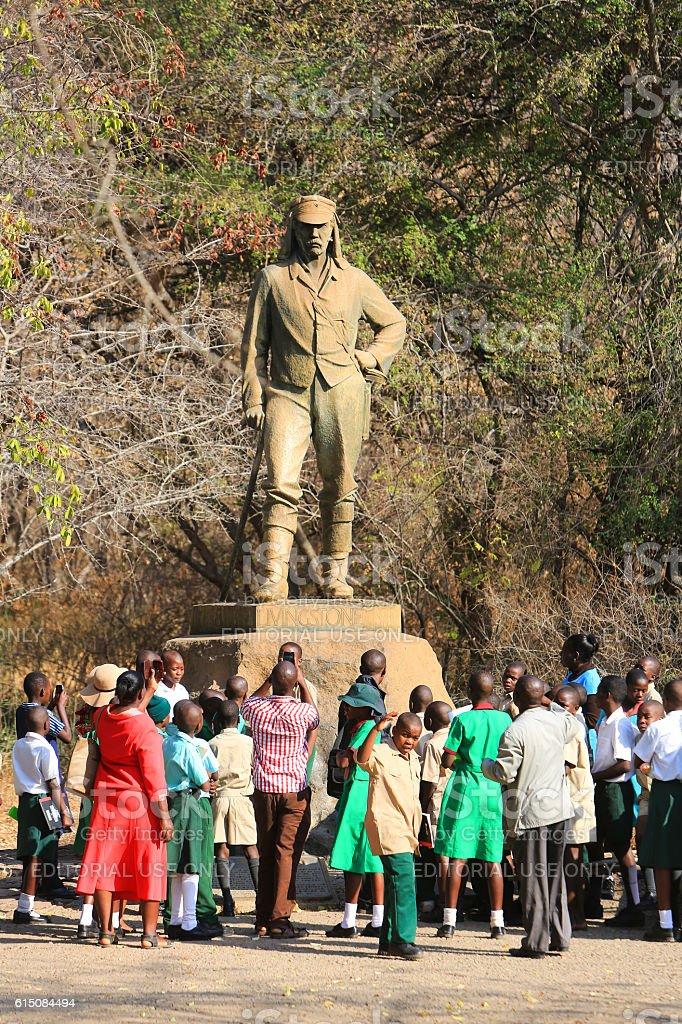 School group admiring Livingstone's statue at Victoria Falls stock photo