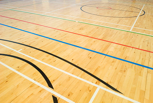 school gymnasium floor - badminton sport stock pictures, royalty-free photos & images