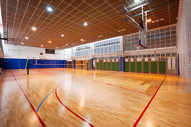 school gymnasium - volleyball sport stock photos and pictures