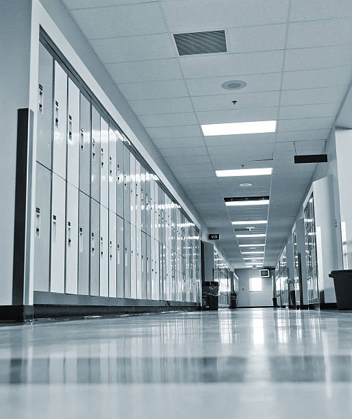 School Hallway With Lockers The lockers in a school open hallway. high school building stock pictures, royalty-free photos & images