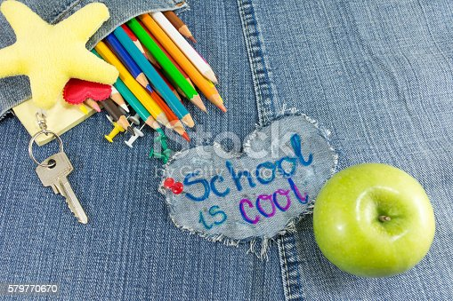 istock School is cool sign with creative learning objects 579770670
