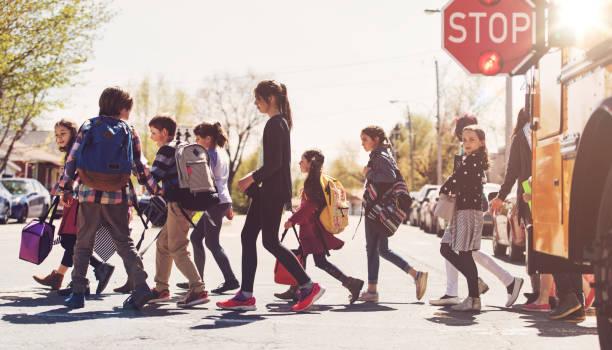 School kids crossing street stock photo