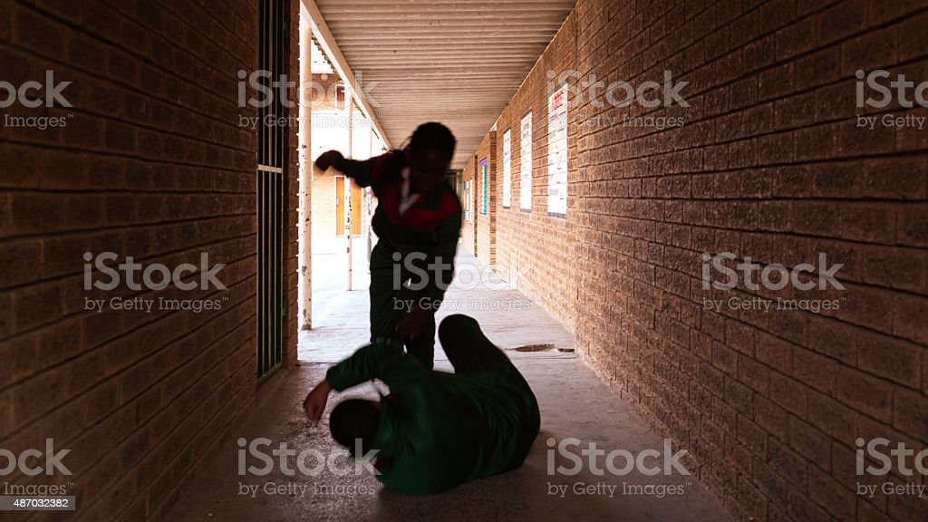School kids fighting stock photo