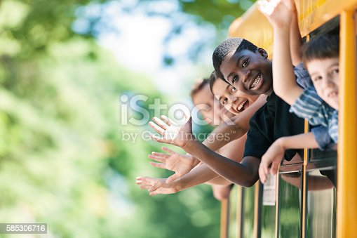 istock School kids hanging out bus windows 585306716