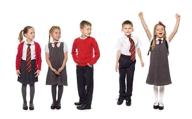 School Kids In A Row, Studio Isolated stock photo