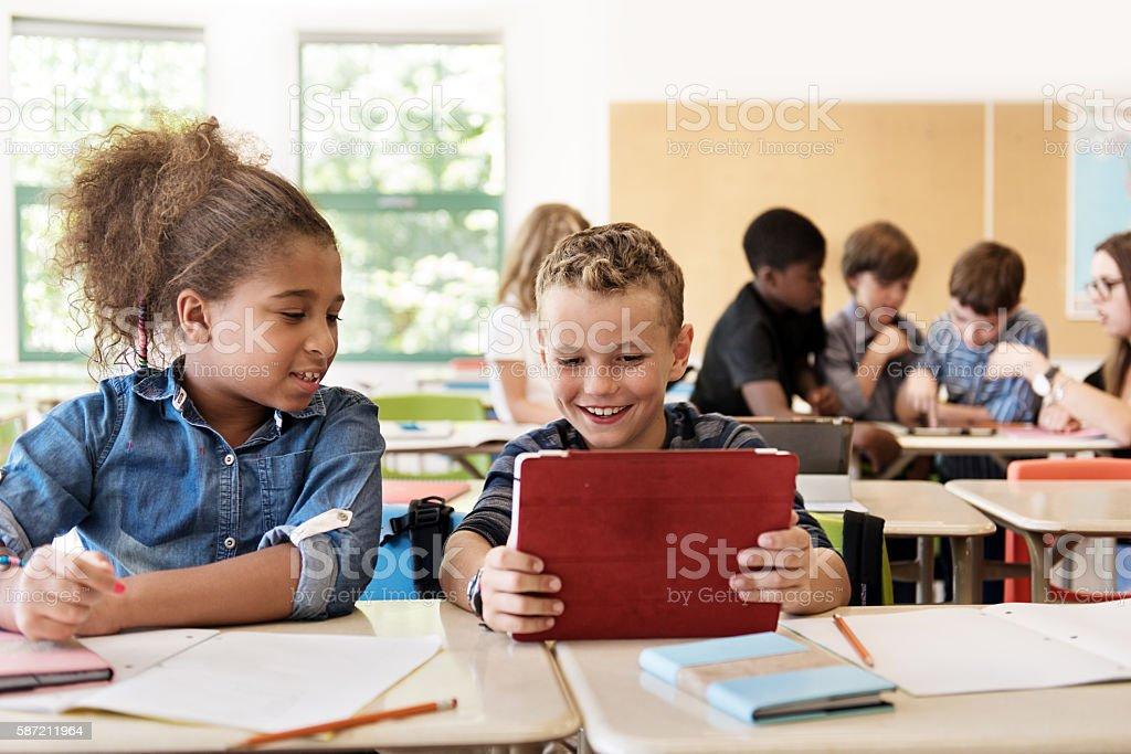 School kids in class using a digital tablet – Foto