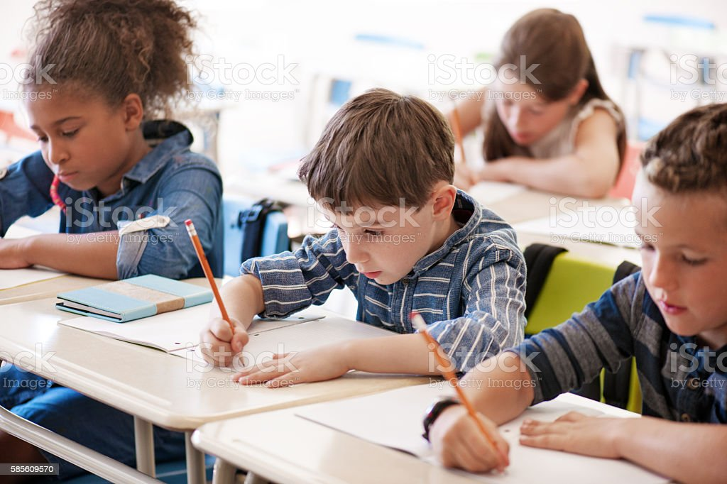 School kids in classroom stock photo