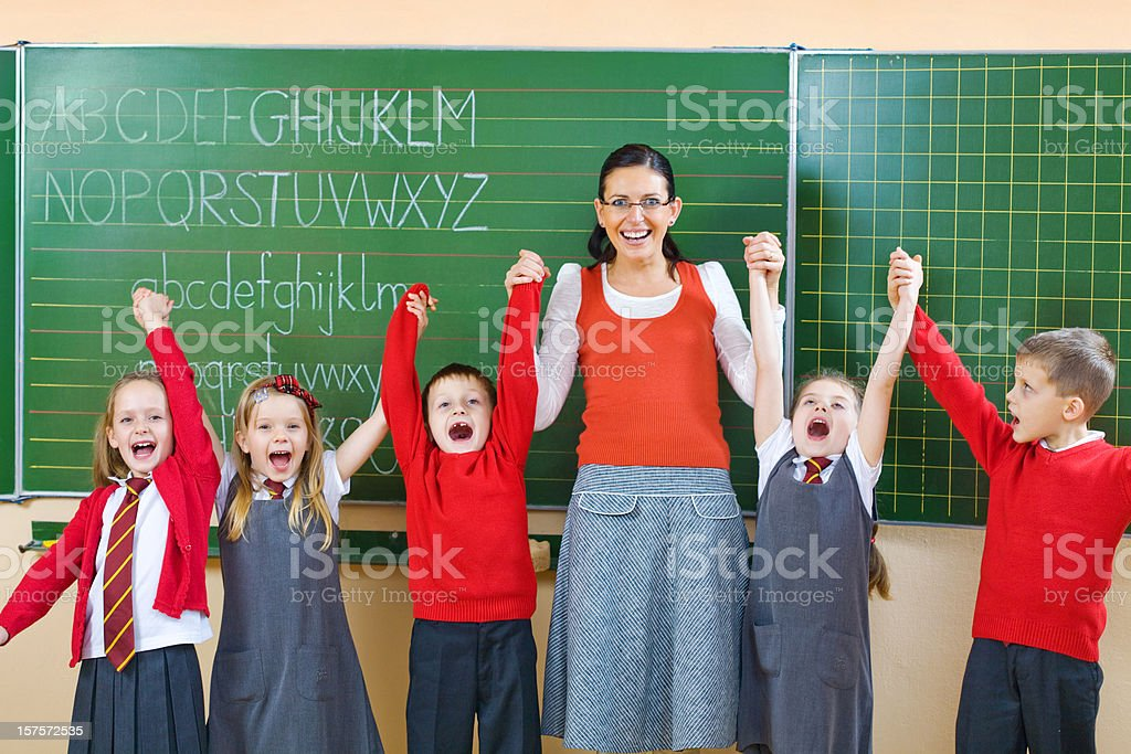 School Kids Posing With Their Teacher, Portrait royalty-free stock photo